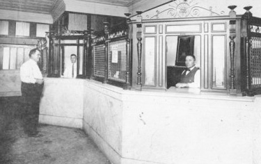 The Peoples Bank of Collinsville, which opened in 1919, is shown several years later. John Myers, a merchant, is on the left.