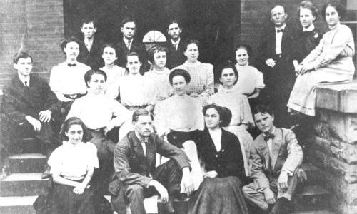 The Jefferson Society of the first freshman class of DeKalb County High School in 1908. Front row: L. to R., Augusta McBroom, Jess Cooper, Vivian Lacy and Gladstone Yewell. Second row: John L. Cross, Mae High and Eula Majors. Third row: Leila Carroll, Gertrude Chitwoon, Alma Bradbury, Ruby Slone and Lula Majors. Fourth row: Luther Lyons, Arthur Downer, John Horton, Prof. Bert Teal, Maude Baxter and a Miss Cooper.